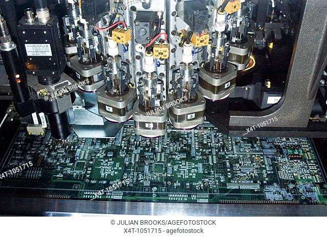 Detail of International Systems, component insertion machine using embedded systems technology to make circuit boards