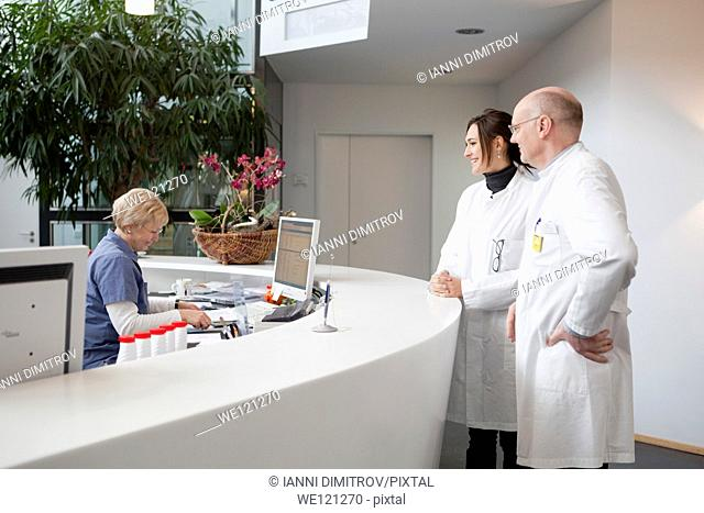 Doctors at the reception of modern hospital