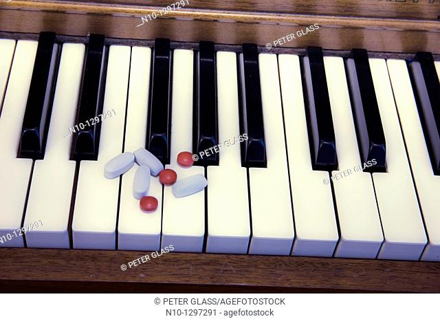 Pills on a piano keyboard