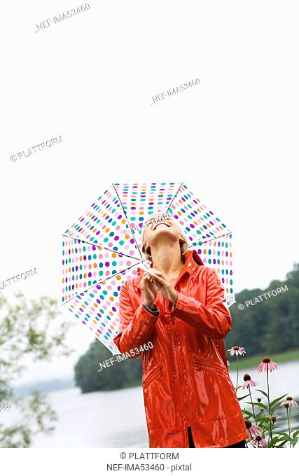 A woman with a dotted umbrella, Sweden