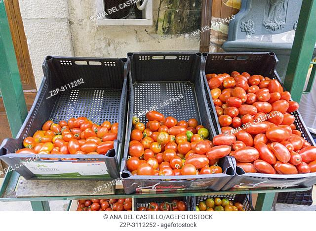 Old town of Bari in Puglia Italy.Fresh tomatoes on a street stall