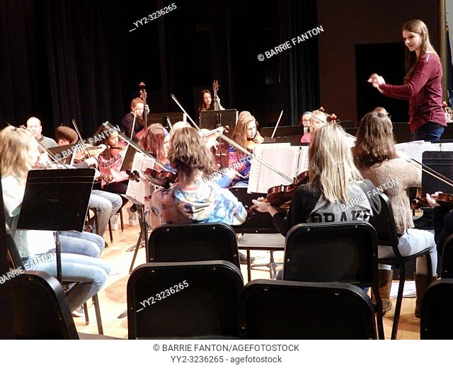 Middle School Girls Playing Stringed Instruments in Orchestra, Wellsville, New York, USA