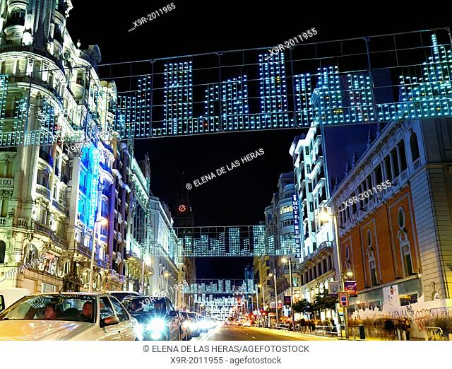 Traffic at Gran via street with string lights at Christmas time. Madrid. Spain