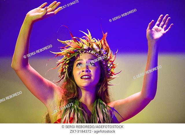 Woman cheerleader dancing on Paul Gauguin cruise ship. France, French Polynesia, Polynesian, South Pacific