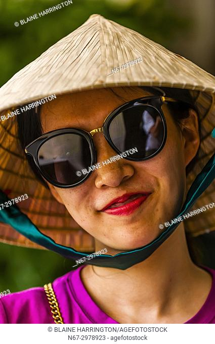 A Chinese tourist wearing a typical Vietnamese conical hat, Reunification Palace (formerly the Presidential Palace), Ho Chi Minh City (Saigon), Vietnam