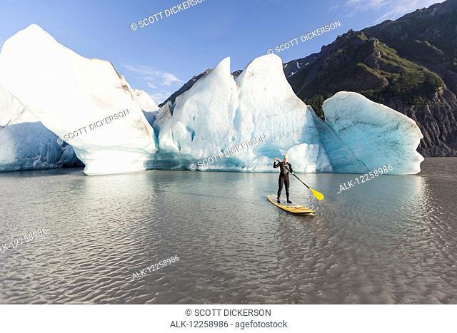 Person paddleboarding at Grewingk Glacier, Kachemak Bay State Park, Southcentral Alaska