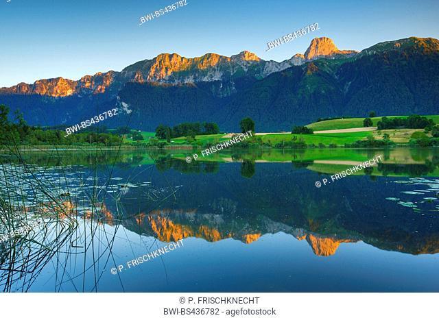 Stockhornkette reflecting in lake Uebeschisee, Switzerland