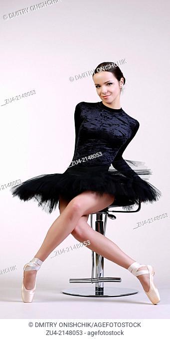 Ballerina posing in black tutu