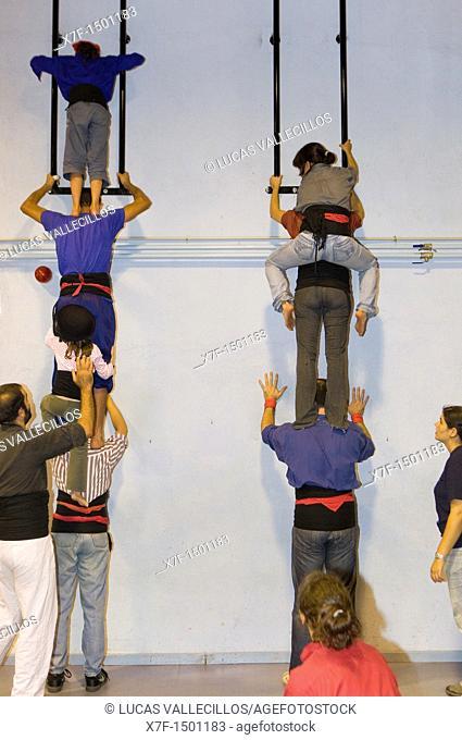 Castellers de la Vila de Gracia training 'Castellers' building human tower, a Catalan tradition Headquarters of Castellers de la Vila de Gracia Barcelona, Spain