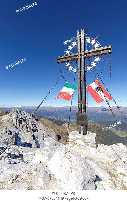 the peak of the mount cavallino (Gr. Kinigat) on the border between Italy and Austria with the cross of Europe and the flags of the two neighboring states