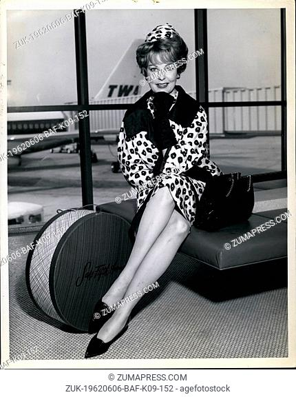 Jun. 06, 1962 - Breathtaking is the word for lovely Arlene Dahl, seen here after arriving by TWA Star Stream from Los Angeles