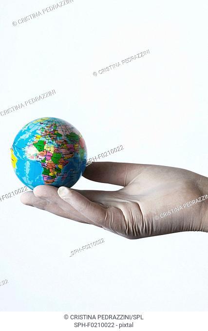 Person holding small globe