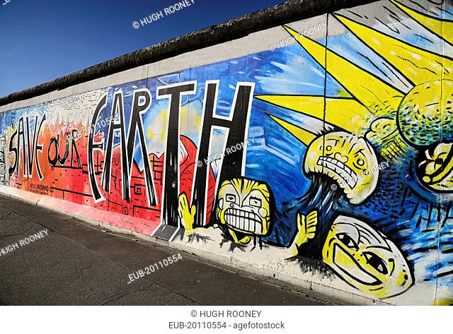 The East Side Gallery a 1.3 km long section of the Berlin Wall Mural known as Save our Earth by Artist Indiano