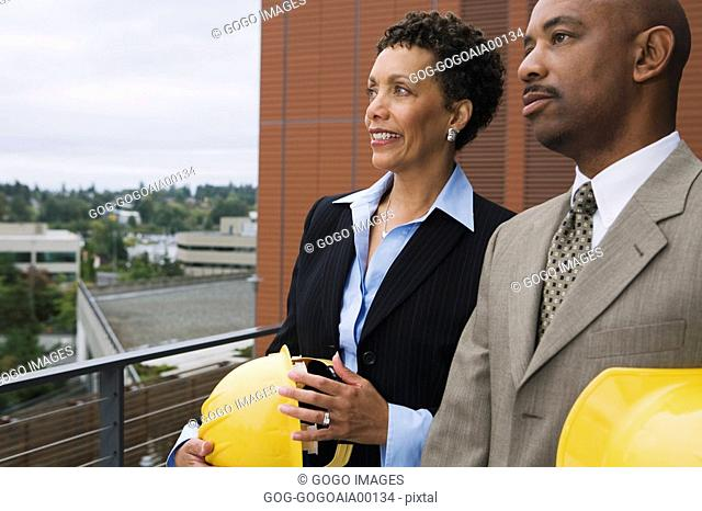 African businesspeople holding hard hats