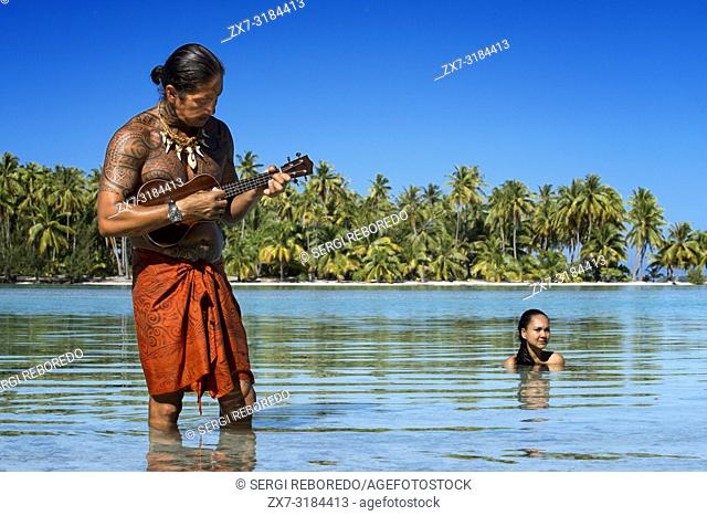 Island of Taha'a, French Polynesia. A local boy plays the ukulele to woo your girl at the Motu Mahana, Taha'a, Society Islands, French Polynesia, South Pacific