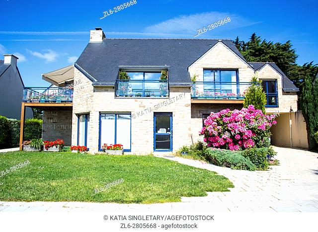 Typical blue brittany house made of stone and Gorgeous landscape and flowers France