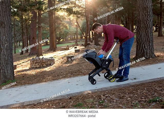 Father holding his baby boy in the park