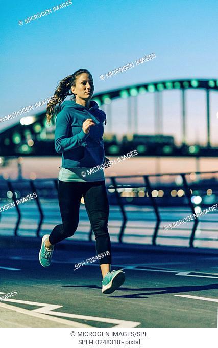 Jogging on riverside