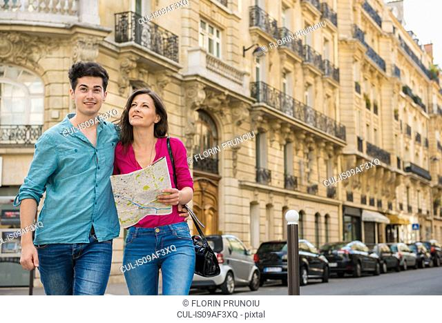 Young couple with map, Paris, France