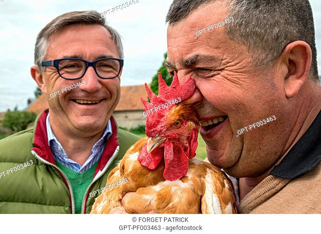 LAURENT CLEMENT, MICHELIN-STARRED CHEF OF THE COURS GABRIEL, AND DIDIER GRANDVILLAIN AT HIS FREE-RANGE CHICKEN FARM, FARM PRODUCE OF THE LAND OF THE...