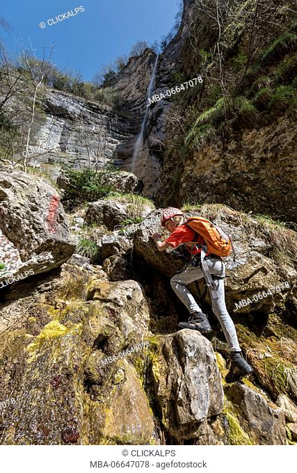 Ferrata Burrone, Mezzocorona, Trentino, Italy. Mountaineer in the gorge Burrone