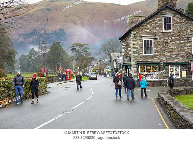 Hikers and walkers in Grasmere village in the Lake District national park on a winters day,Cumbria,England