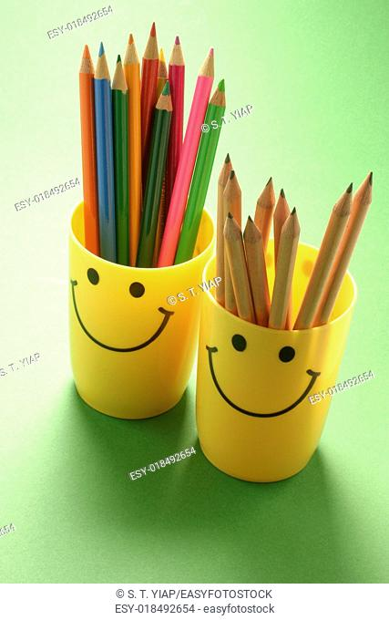 Smiley cups and pencils