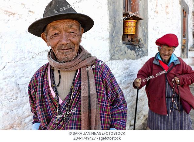 Two old men circling Jampa Lhakhang Temple, Jakar, Bumthang, Bhutan, Asia