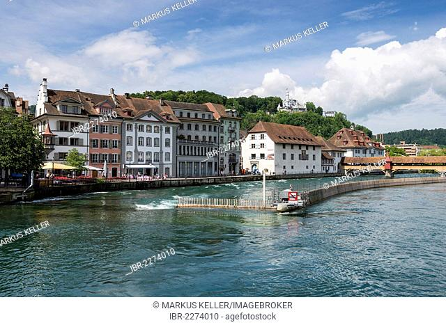 View across the Reuss river, Nadelwehr weir and the historic disrict, Hotel Chateau Guetsch on the mountain, Lucerne, canton of Lucerne, Switzerland, Europe