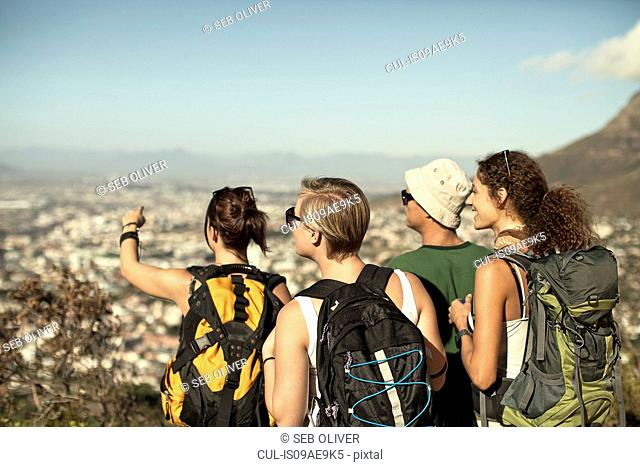 Friends looking at view from Table Mountain, Cape Town, South Africa