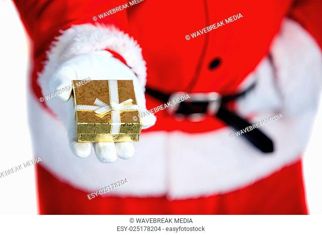Santa claus holding a gift box in hand
