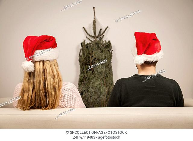 couple with caps on christmas eve