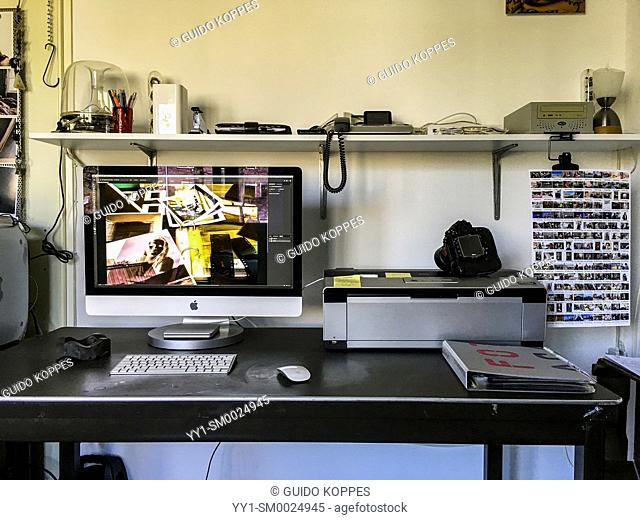 Tilburg, Netherlands. Workplace of a photographer and photo-journalist at home, aimed at image processing, archiving and uploading to the AGE FotoStock website