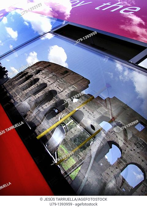 Mirror image on the glass of a bus in a historic building in Rome, Italy, Lazio, Europe