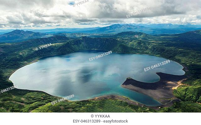 Crater Karymsky Lake. Kronotsky Nature Reserve on Kamchatka Peninsula. View from helicopter