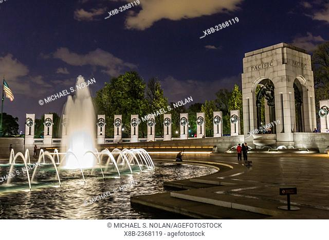 The fountains and sculpture of the World War II Memorial lit up at night, Washington D.C. USA