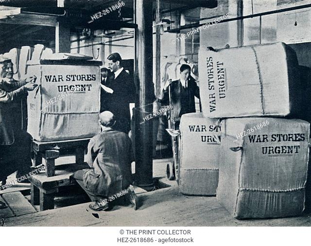 Packing the bales of khaki for despatch to the Government, c1914