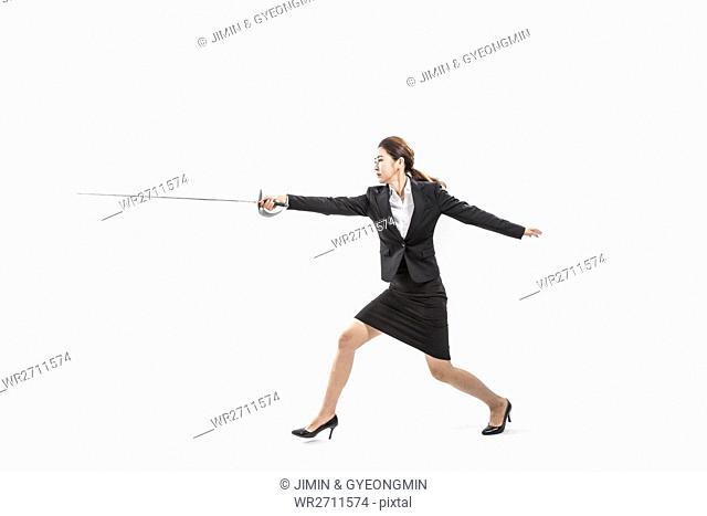 Businesswoman doing fencing