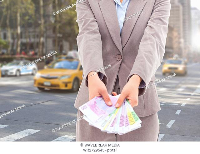 Businesswoman holding euro banknotes