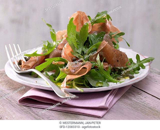 Rocket salad with Parma ham and caper dressing
