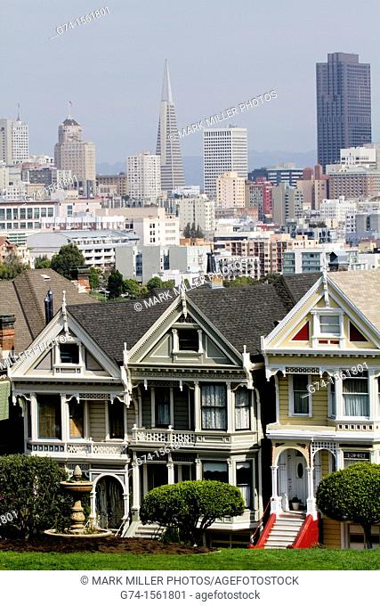 """Victorian Homes on Steiner Street from Alamo Square and San Francisco city skyline, San Francisco, California, USA  """"Editorial Only"""""""