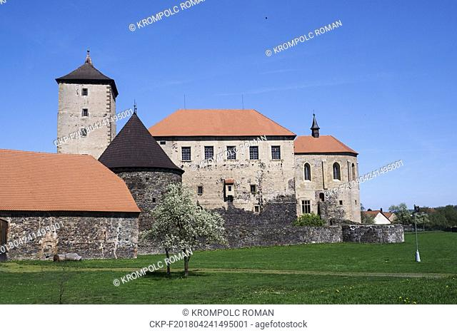 Water Castle Svihov with blooming tree on the foreground. (CTK Photo/Roman Krompolc)