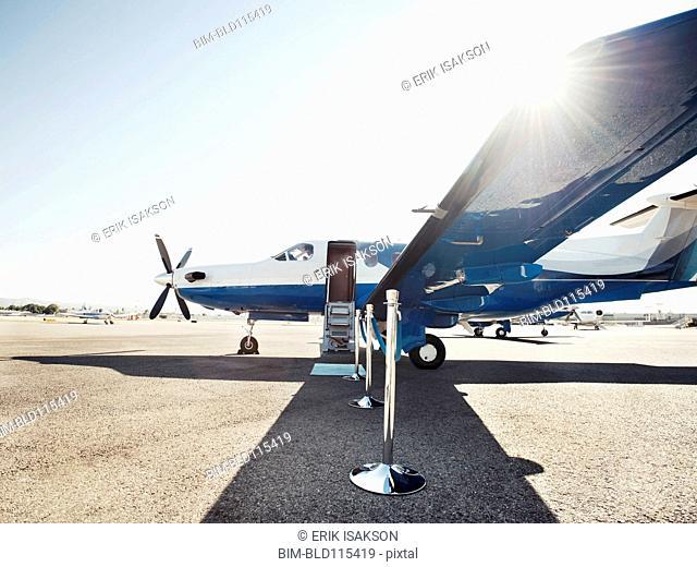 Velvet rope by airplane on runway