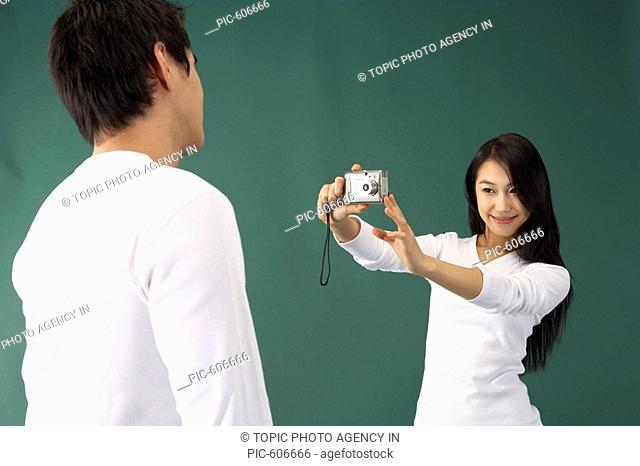 Couple Taking Pictures with Digital Camera, Korean