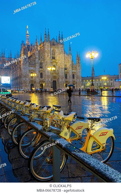 Milan's Duomo cathedral in winter with snow and artificial lights. Milan, Lombardy, Italy