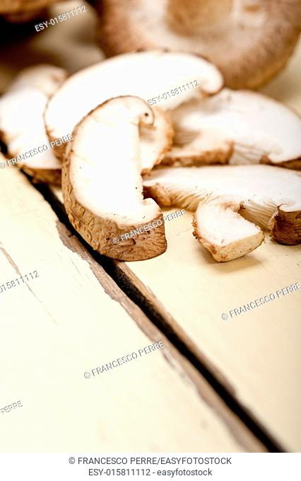 fresh shiitake mushrooms on a rustic wood table