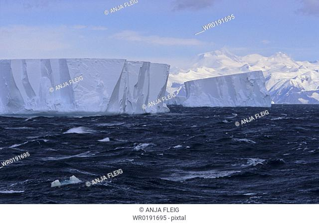 Tabular icebergs with Admiralty Mountains Range in background Nearby Cape Adare, Ross Sea, Antarctica
