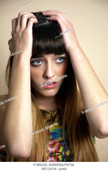 Teenager Holding Head in Anxiety / Sorrow