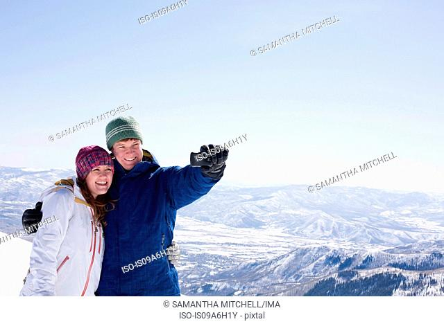 Young couple photographing selves, Brighton ski resort, Utah, USA