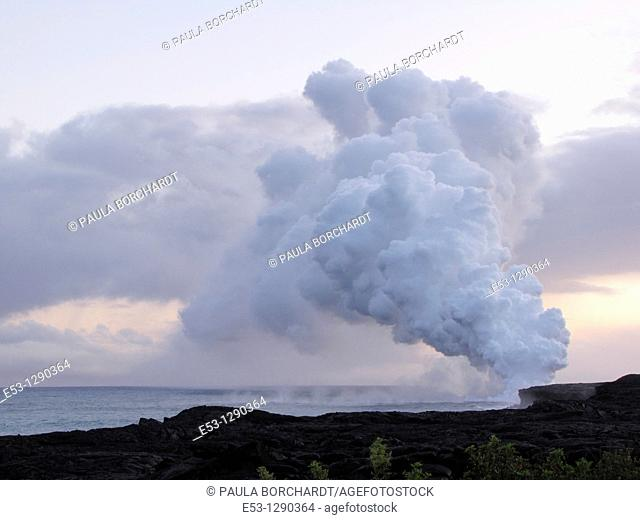 Billowing steam rising from 2000-degree lava flowing into the sea, from the Pu'u O'o vent of Kilauea volcano, Hawaii Volcanoes National Park, Hawaii, USA